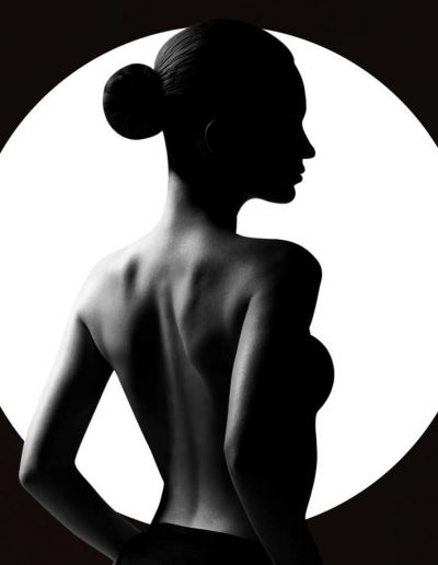 Black and white silhouette portrait of a young girl on a white circle