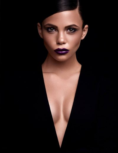 A beautiful art portrait of a young girl with a V-shaped neckline on black background
